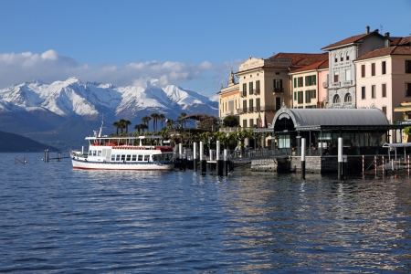fantastic landscape of Lake Come with Bellagio village and snowy mountains at horizon, Lombardy, Italy, Europe