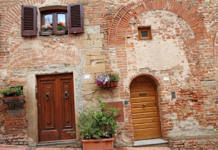 picturesque doorways to the tuscan homes in  Certaldo, home of the family of Giovanni Boccaccio, who died and was buried here. Italy, Europe photo