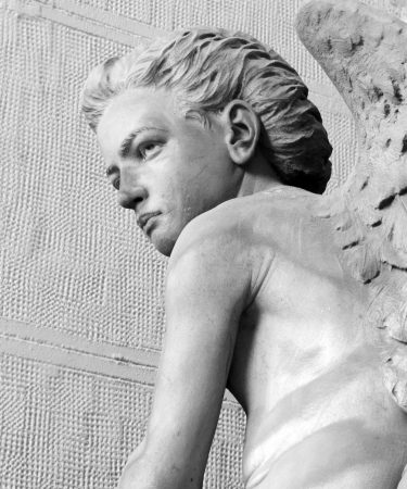 monumental cemetery: detail of angelic statue on monumental cemetery in Italy, Staglieno, Genoa,Liguria, Italy, Europe Stock Photo