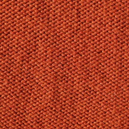 orange knitting fabric  background photo