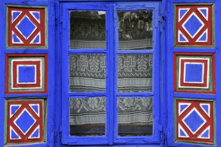window open: country window with vivid painted shutters in open air museum , National Village Museum (Muzeul Satului ) in Bucharest, Romania, Europe