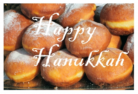 Happy Hanukkah greetings card with traditional fried doughnut photo