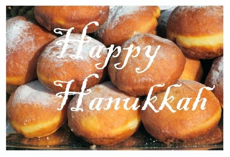jewish cuisine: Happy Hanukkah greetings card with traditional fried doughnut