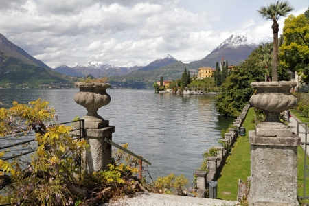 fantastic landscape of lake Como seen from garden of Villa Monastero, Varenna, Lombardy, Italy, Europe Фото со стока