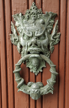 stylish bronze door knocker, Italy, Europe Stock Photo - 16138789