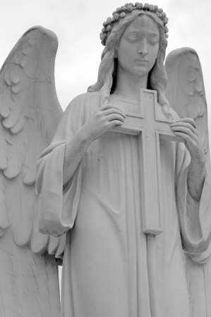 angel cemetery: statue  of angel  holding a cross, cemetery in Italy, Europe