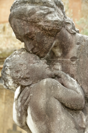 child in mothers arms - sculpture on italian cemetery, Europe photo