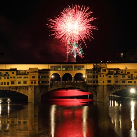 Fireworks over Arno river and Ponte Vecchio on San Giovanni feast, 24th of  June, Florence, Tuscany, Italy, Europe