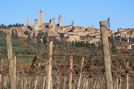 fantastic landscape with medieval towers of  San Gimignano village on hill and vineyards  of famous Vernaccia of San Gimignano wine ,Tuscany, Italy, Europe