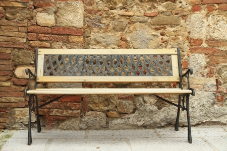 retro metal and wood bench in front of tuscan house, Italy, Europe photo