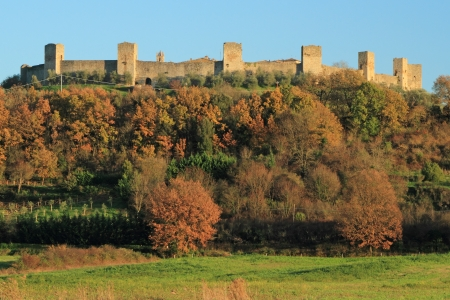 Fantastic Castle of Monteriggioni with its walls and remaining towers in wonderful tuscan landscape in fall colors, Province of Siena, Tuscany, Italy, Europe