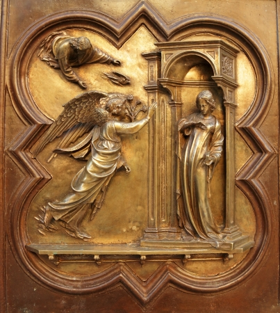 north gate: Annunciation  by Lorenzo Ghiberti, angel Gabriel announce  to Virgin Mary that she would conceive and become mother of Jesus, Son of God,Battistero di San Giovanni ( Baptistry of St. John ),Florence