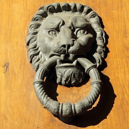 beautiful old door knocker in Florence, Tuscany, Italy, Europe Stock Photo - 17096089