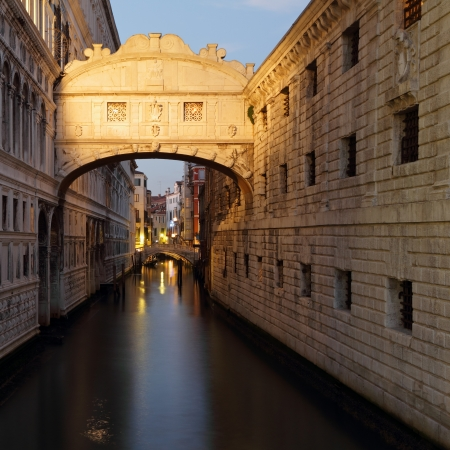 wonderful sunset over Bridge of Sighs - Ponte dei Sospiri. A legend says that lovers will be granted eternal love if they kiss on a gondola at sunset under the Bridge. Venice,Veneto, Italy, Europe. photo