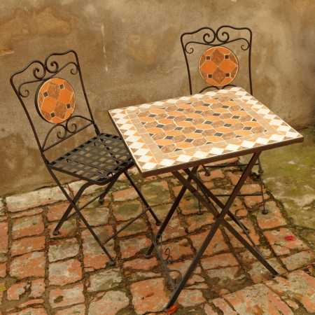elegant garden furniture on tuscan terrace, Italy, Europe photo