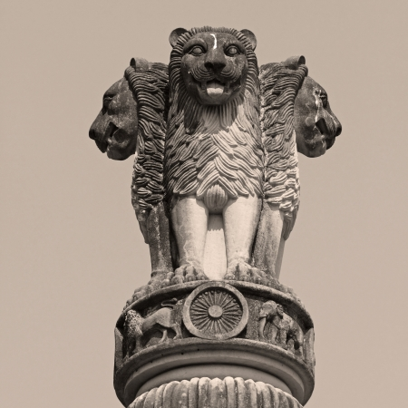 national emblem: sculpture of emblem of India, four lion  symbolizing power, courage, pride and confidence - rest on a circular abacus, park in Malabar Hill, Mumbai, India, Asia