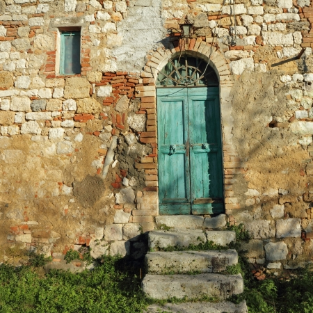 doorway to the tuscan farmhouse, Italy photo