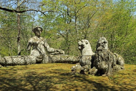 The bench like siren and two lions sculptures in Park of the Monsters (Parco dei Mostri ), also named Sacred Grove ( Sacro Bosco ), Bomarzo , Italy, Europe photo