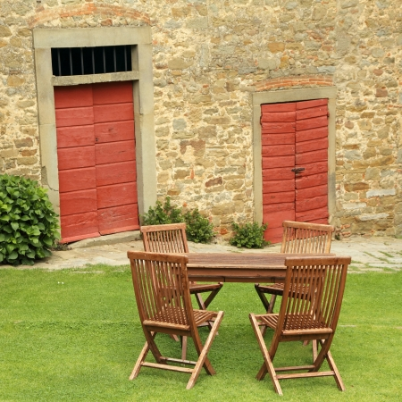 wooden garden furniture on lawn on tuscan courtyard, Italy, Europe Stock Photo - 20662834