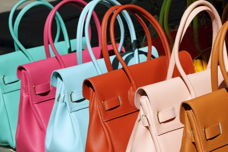 fancy bag: colorful leather handbags collection on florentine market, Florence, Italy, Europe