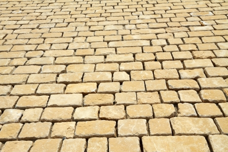 street pavement texture made of rectangle rough classic rock  tiles  photo