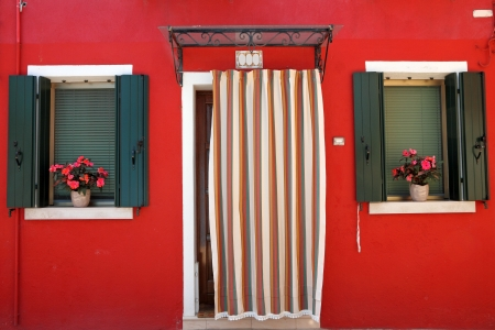 colorful front door to the house on the Burano island, Venezia, Veneto, Italy, Europe Stock Photo - 21161031