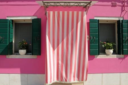 sweet doorway to the house in Burano village, Venice, Veneto, Italy, Europe  photo
