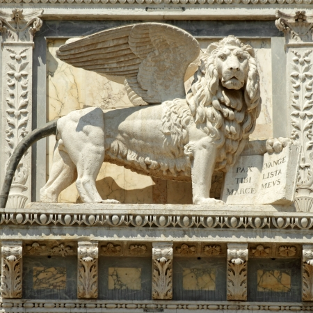 winged lion carving on facade of the Scuola Grande di San Marco building, now venetian hospital, Venice, Veneto,Italy, Europe photo