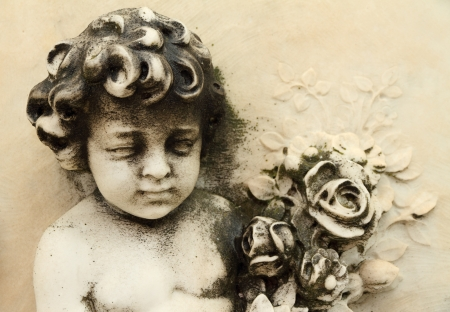condolence: antique angelic figure with bouquet of flowers  on marble facade Stock Photo