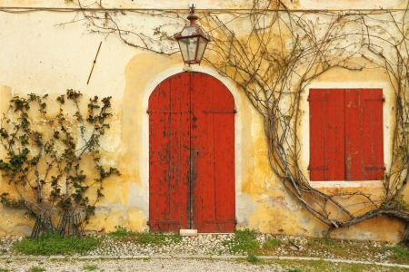 beautiful colorful old doorway  with blinded door and window to the  rural  tuscan house, Italy, Europe Stock Photo - 21758335