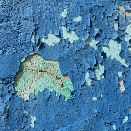 peeling colorful painted old stucco wall, Burano, Italy photo