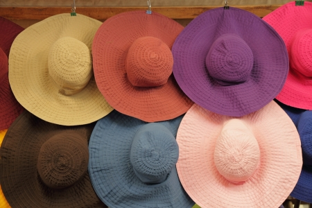 colorful summer woman sun hats on market in  Florence, Italy, Europe photo