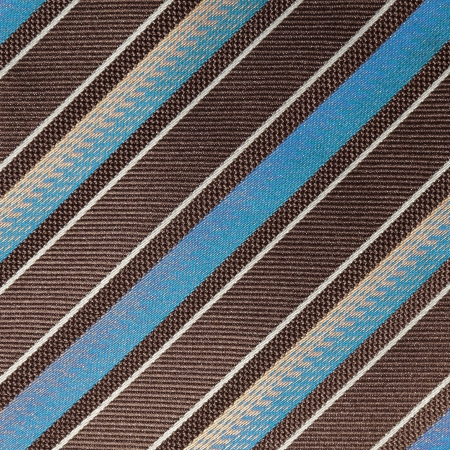 slant: fabric with diagonal various widths  blue , black and white stripes as background