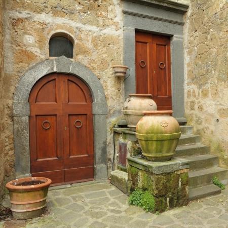 italian village: two antique doors in italian village Civita di Bagnoregio, province Viterbo,Lazio, Italy, Europe