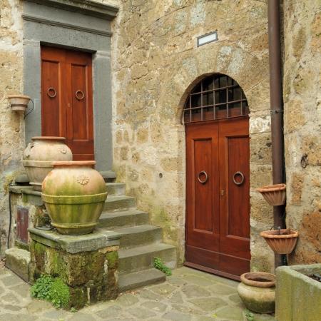 italian village: twoantique doors in italian village Civita di Bagnoregio, province Viterbo,Lazio, Italy, Europe