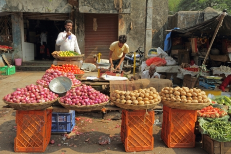 MUMBAI, INDIA -NOV 27  Street vendors sell vegetables on Nov  27, 2010 in Mumbai, India  Agricultural sector makes up 18 1  of GDP  India is the biggest producer of fruits and second for vegetables