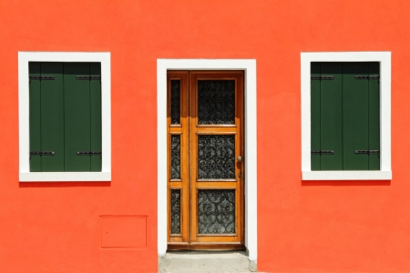 front door in vivid painted  house in Burano village, Venice, Italy, Europe Stock Photo - 21758449