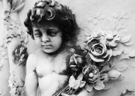 cemetery  angel  with bouquet of flowers , Monumental cemetery San Michele in Venice, Italy, Europe  photo