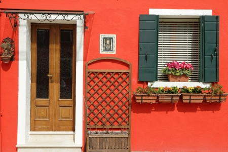 entrance to the typical vivid painted house on Burano island, Venice, Veneto, Italy, Europe Stock Photo - 21758468