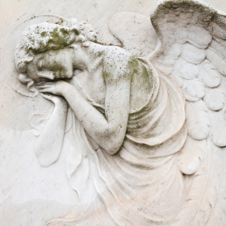 burial: sleeping angel - antique decoration on tombstone, monumental cemetery San Michele, Venice  ,Italy, Europe