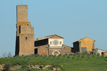 tuscania: landscape with antique church of Saint Peter  San Pietro in Italian , in Lombard - Romanesque style, Tuscania, province Viterbo, Lazio, Italy, Europe