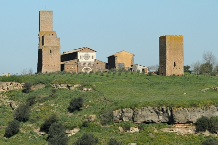 etrurian: landscape with antique church of Saint Peter  San Pietro in Italian , in Lombard - Romanesque style, Tuscania, province Viterbo, Lazio, Italy, Europe