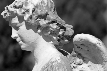 monumental cemetery: detail of antique sculpture of  angel, monumental cemetery in Italy, Europe