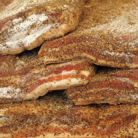 many pieces of  tuscan pancetta   rigatino toscano   on farmers market during EXPO RURALE Toscana  in Florence, Italy, Europe photo