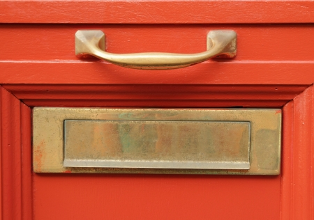 mail slot: brass mailbox slot  on vivid red door, Italy, Europe