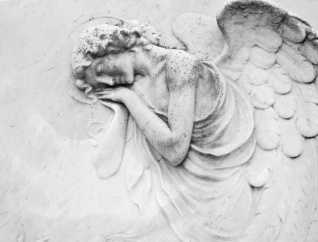 angel headstone: sleeping angel - antique decoration on tombstone, monumental cemetery San Michele, Venice ,Italy, Europe