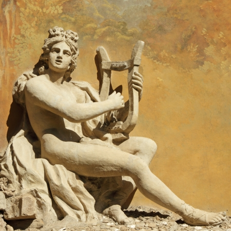 ancient god with the lire instrument -  decorative carving on wall, Florence photo