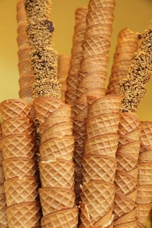 gelato: closeup of stack of empty waffle ice cream cones in an Ice cream shop  in Italy Stock Photo