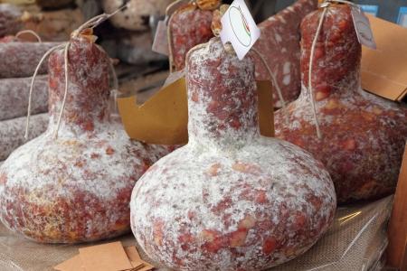 fiasco: salami sausage in shape of bottle   salami al fiasco  on food market, tuscan regional specialty, Italy
