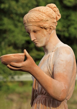 woman carrying dish - classic sculpture photo
